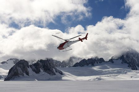 franz: Helicopter flying over franz joseph glacier in New Zealand