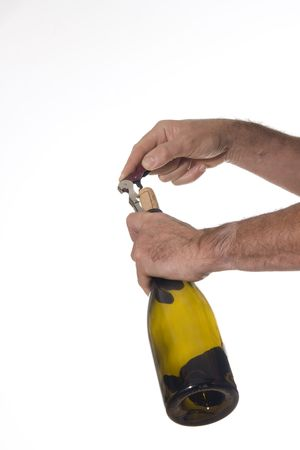 Man opens a bottle of wine with professional cork screw photo