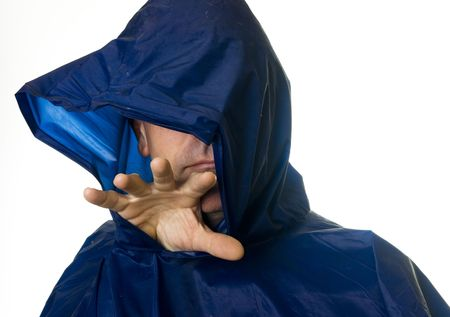 Creepy man in blue rain coat stretching out one hand