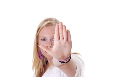 Girl holding hand up saying stop. Face visible photo