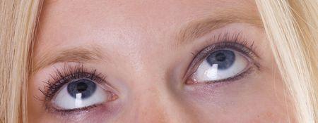 close your eyes: Blue eyes of girl looking upwards