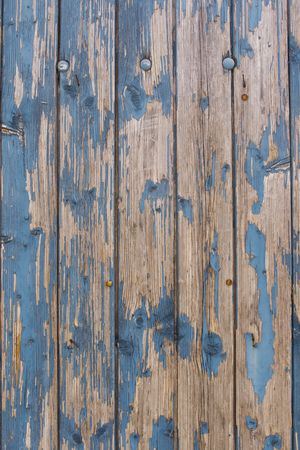 Weathered wooden wall with old blue paint photo