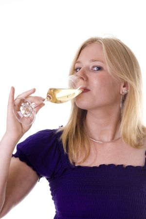 Attractive blonde girl looking at camera drinking a glass of champagne photo
