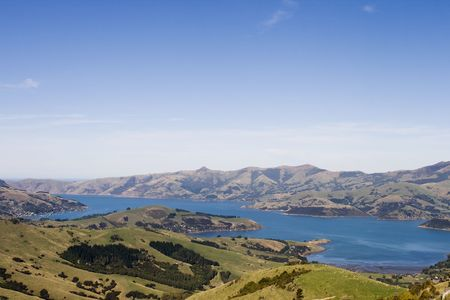 hilltop: Hilltop view of Akaroa bay in the banks peninsula region, South Island New Zealand Stock Photo