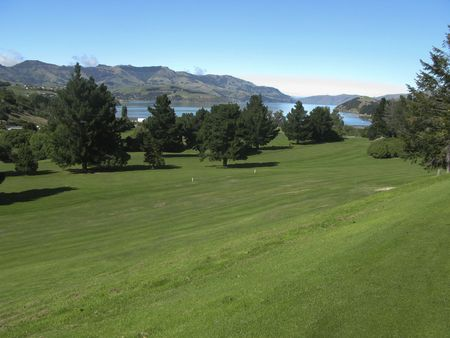 Beautiful golf course with view on Akaroa Bay in New Zealand photo