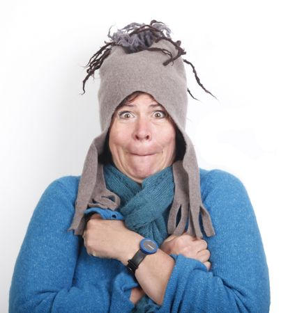 shivering: Shivering middle aged woman in funny felt cap and in blue sweater