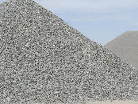 Two piles of gray gravel at industrial site photo