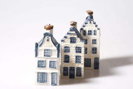 dutch canal house: Three miniature stone houses in Delft blue