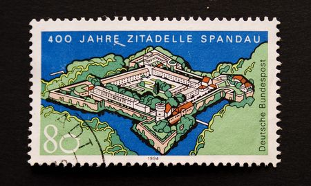 send to prison: Postage stamp with image of prison Spandau in Germany Stock Photo