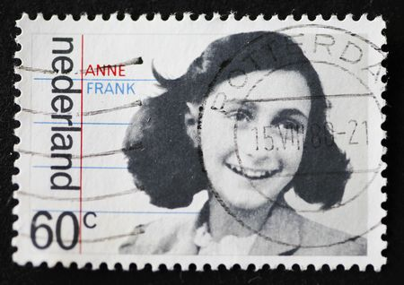 Close-up of a Dutch stamp showing a portrait of Anne Frank. This stamp was issued in 1980.