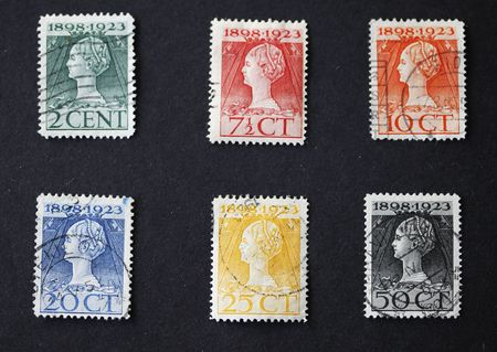 Series of antique Dutch postage stamps in art nouveau style with female head photo