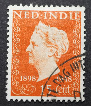 wilhelmina: Old Dutch Indies postage stamp with image of Queen wilhelmina commemorating her 50 years on the throne Editorial