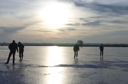 wintersport: Dutch ice skaters on a frozen lake Stock Photo