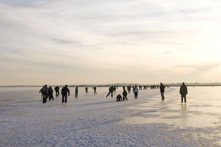 Ice skating on a frozen lake in the Netherlands Stock Photo - 6092072