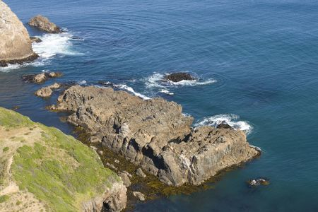 turqoise: Famous New Zealand steep and rocky coast with turqoise ocean Stock Photo