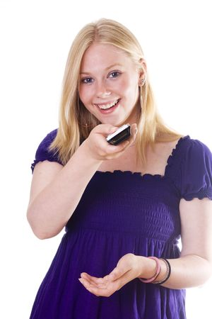 Blonde girl with remote control on white background photo