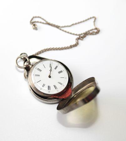 Antique silver pocketwatch in silver case photo
