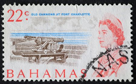 BAHAMAS-CIRCA 1960�s Vintage postage stamp with image of Queen Elizabeth and the cannons at Fort Charlotte Stock Photo - 6272445