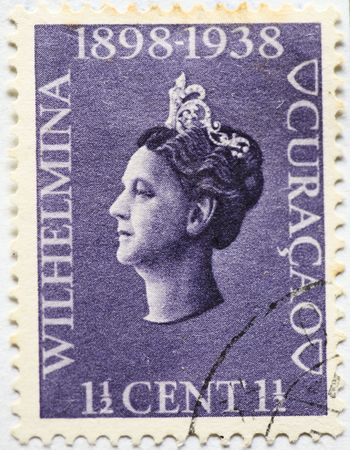 wilhelmina: THE NETHERLANDS CIRCA 1938 Antique Curacao postage stamp with image of Queen Wilhelmina commemorating her forty years reign Wilhelmina Helena Pauline Marie of Orange-Nassau; August 31, 1880 � November 28, 1962 was queen regnant of the Kingdom of the Nethe