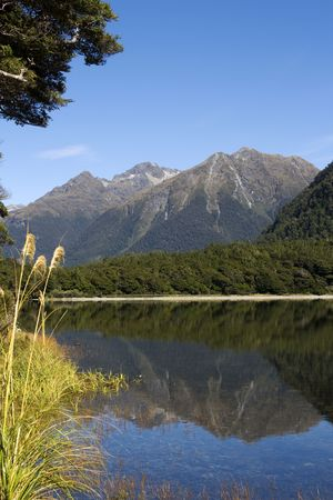 Mountain range in New Zealand reflected in lake photo