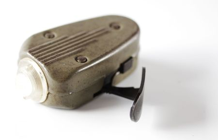 dynamo: Historical hand driven mechanically powered torch light used during the second world war. Stock Photo