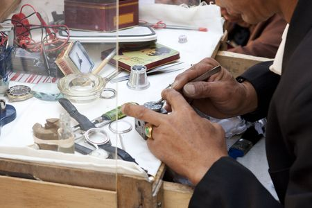 Chinese watchmaker working outdoors photo