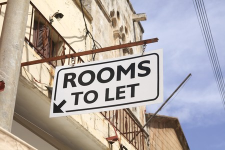 bb: Rooms to let sign on a house in Greece Stock Photo