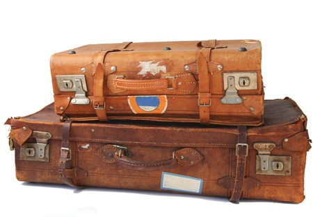 weathered: Vintage weathered leather suitcasess on top of eachother Stock Photo