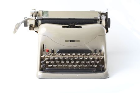 Old fashioned typewriter on white background photo