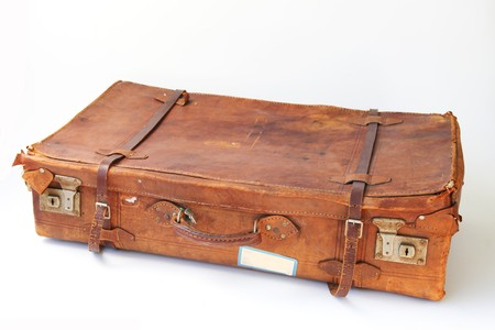 Vintage weathered leather suitcases sideview photo