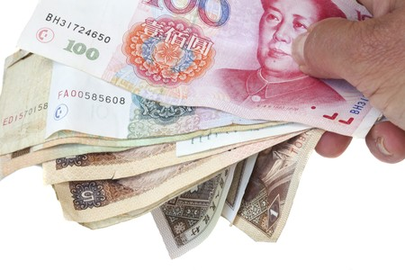hand with chinese money notes with image of Mao photo