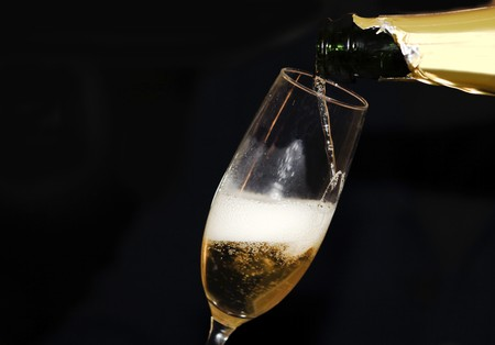 Pouring champagne in a champagne flute photo