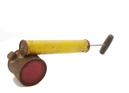 propellant: Vintage rusty red and yellow insecticide sprayer
