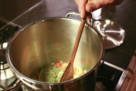 stir up: Wooden ladle in soup pan Stock Photo