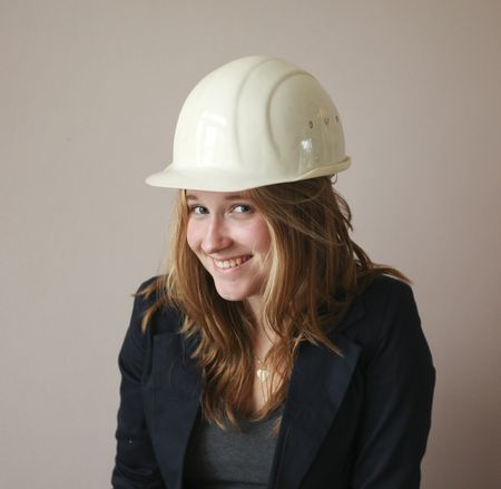 Pretty woman with helmet looking at camera photo