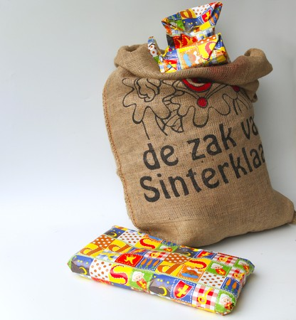 Dutch Sinterklaas celebration with a big bag filled with presents  photo