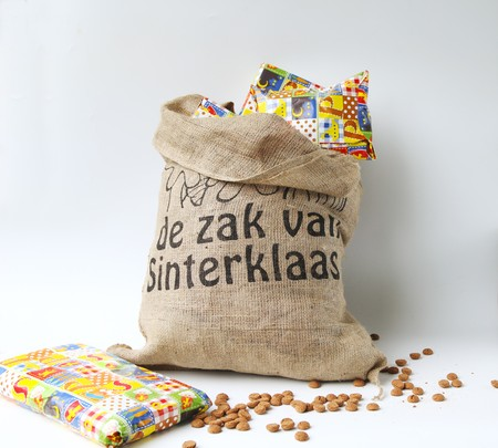 Dutch Sinterklaas celebration with a big bag filled with presents and gingercandy photo