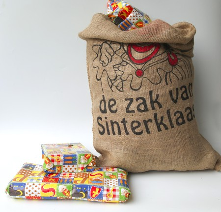 Dutch Sinterklaas celebration with a big bag filled with presents Stock Photo - 8217925