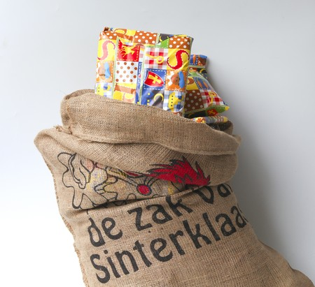 Dutch Sinterklaas celebration with a big bag filled with presents Stock Photo - 8217928