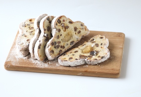 christmas paste: Christmas stollen bread in slices on a cutting board Stock Photo