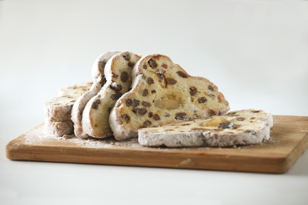 Christmas stollen bread in slices on a cutting board Stock Photo - 8467810