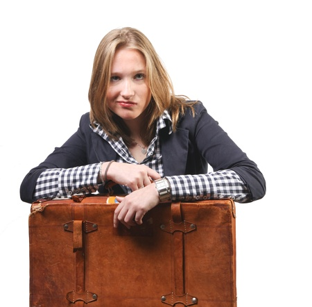 Young business woman with bored expression waiting for transport Stock Photo - 8547819