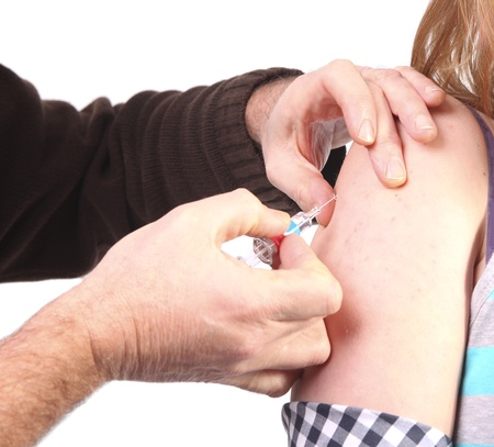 Injection in arm of young woman photo