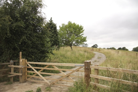 cotswold: Walking path with wooden fence in the Cotswold