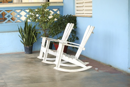 Two wooden rocking chairs on a porch in the Caribbean photo