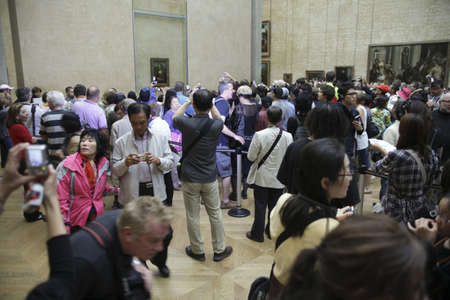 LOUVE, PARIS,FRANCE-SEPTEMBER 20TH 2010: Tourists trying to make a photograph of the Mona Lisa in paris