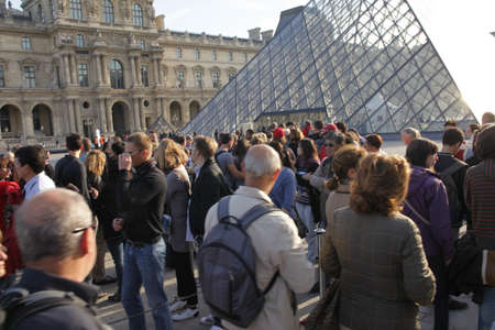 LOUVRE, PARIS, FRANCE-SEPTEMBER 20TH 2010: Visitors waiting in long line for the entrance of the louvre