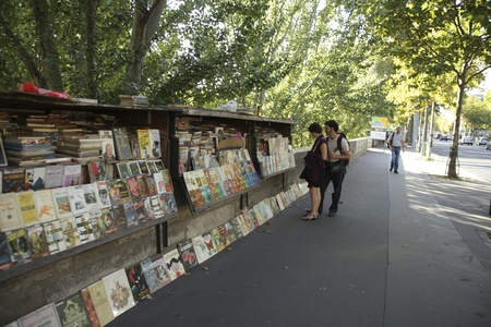 PARIS, FRANCE - september 19th, 2010: Second-hand book market on quay of river Seine near cathedral Notre Dame de Paris.