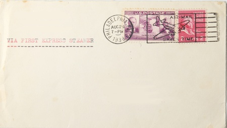 Vintage blank envelope with us postage stamps and postmarked 1939. Postmark says airmail saves time  but typing says  via first express steamer . War had starrted in Europe.