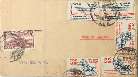 Big brown envelope with many Mexican postage stamps sent as airmail via New York
